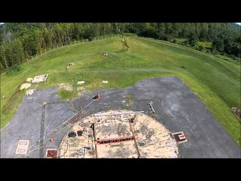 Two quadcopter drones over an old missile base