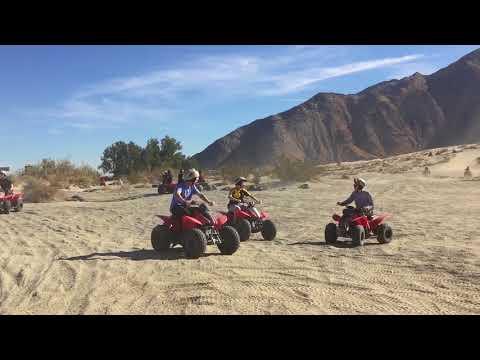Riding ATVs fast downhill - Palm Springs
