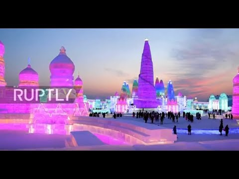World's largest ice festival wows tourists as illuminations light up Harbin sky