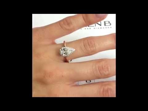 Pear Diamond Halo Engagement Ring in Rose and White Gold