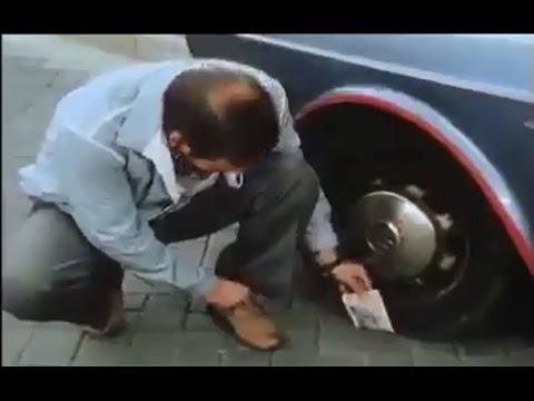 Money Stuck Under Wheel