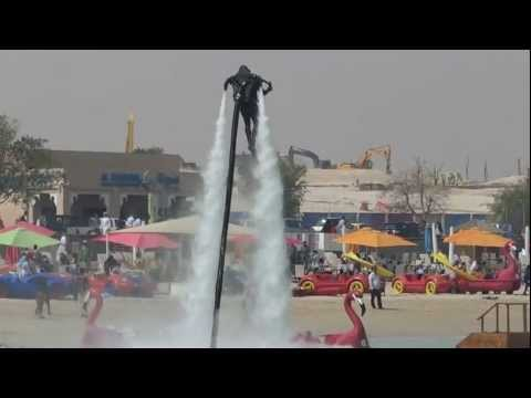 MAN FLYING OVER WATER-