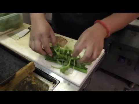 Watanabe prepares a signature dish at Osaka in Santiago