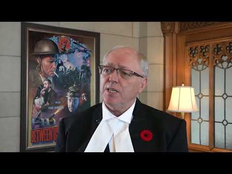 Speaker George J. Furey honours Private Tommy Ricketts