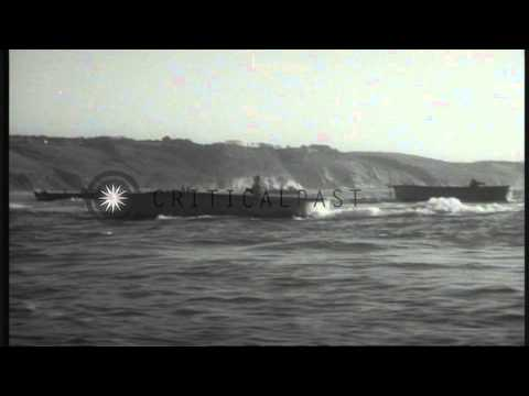 US soldiers disembark from landing crafts and run towards a beach for the D-Day i...HD Stock Footage