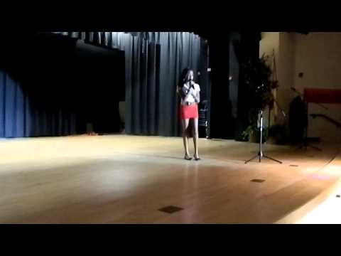 Lourdes singing at the talent .