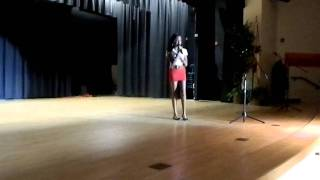 Lourdes singing at the talent show.