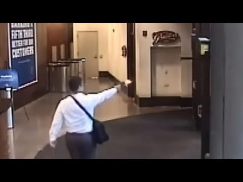Chilling new video shows police response to deadly bank shooting