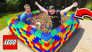 PUTTING 50,000 GUMBALLS IN A LEGO POOL!