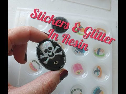 Using stickers and glitter with resin to make magnets and jewelry