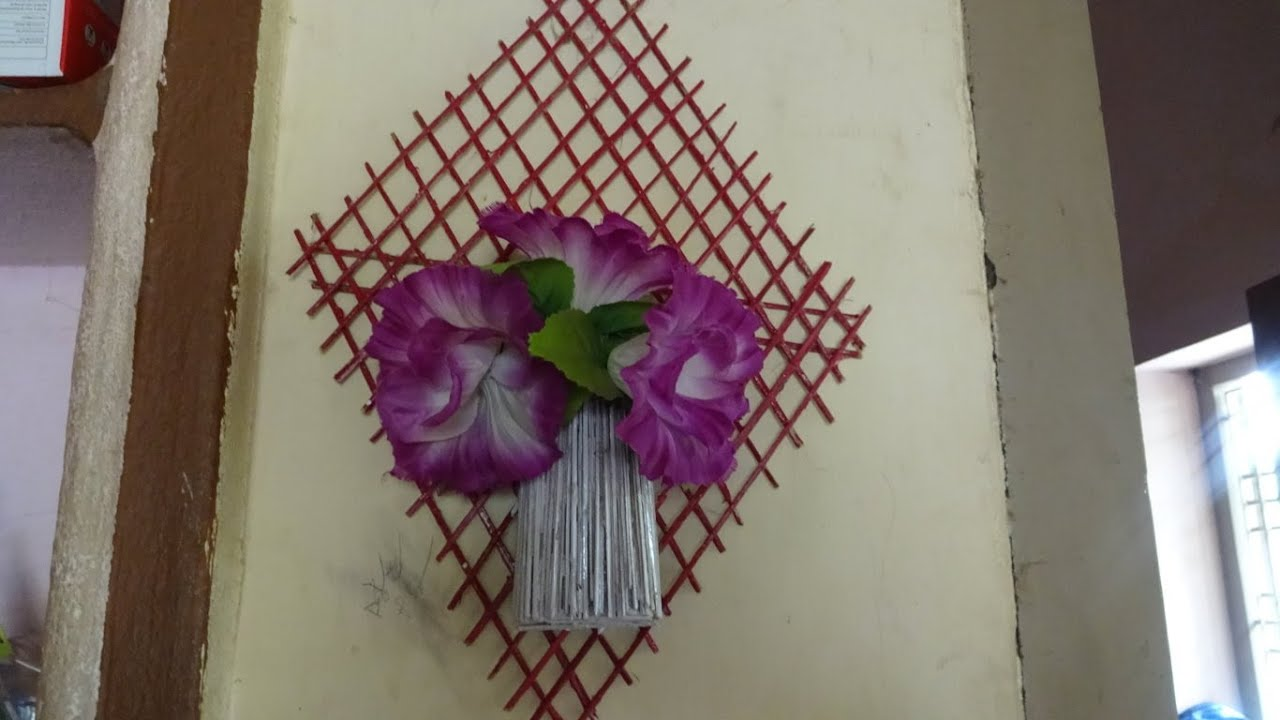 How to make wall hanging wall flower vase video by for How to make decorative wall hangings at home