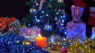 Pan shot of Christmas tree decorations in a dark room in India - Christmas celebration