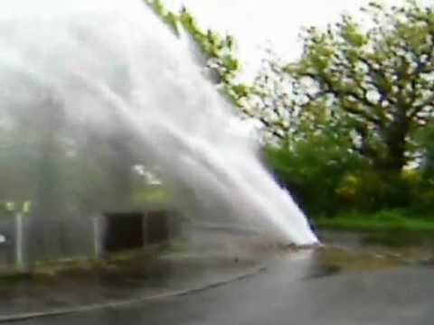 Burst Water Pipe Showers Homes And Cars In Running Waters