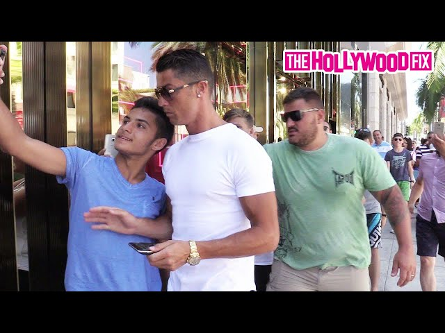 Cristiano Ronaldo Pushes A Young Fan While Shopping On Rodeo Drive In Beverly Hills 7.26.16