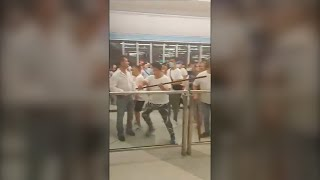 Hong Kong protests: Masked men storm train station in viral video