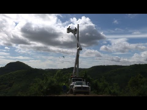 Pole to pole, linemen work to restoring power in Puerto Rico