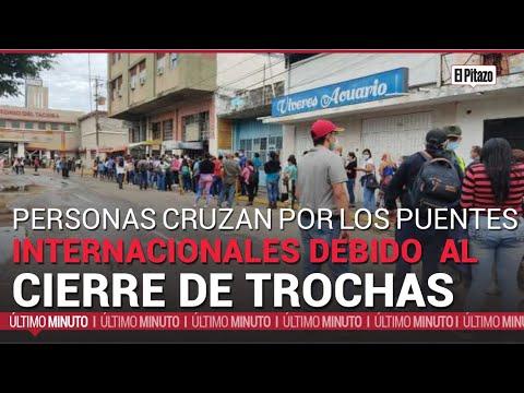 Download Frontera | Personas cruzan por los puentes internacionales debido al cierre de trochas