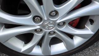 how to put on a spare tire and jack your car up