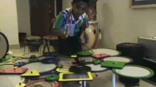 Rakshit Sharma-8 year old Rakshith playing the REMO SoundShapes(TM) to Carnatic Rhythms.mp4