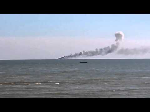 Ukraine War • Ukrainian coast guard ship burns and sinks after the Russian air raid