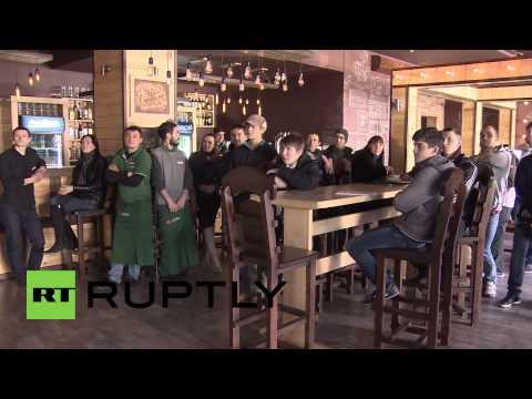 Russia: Simferopol citizens watch Putin's speech live in city cafes
