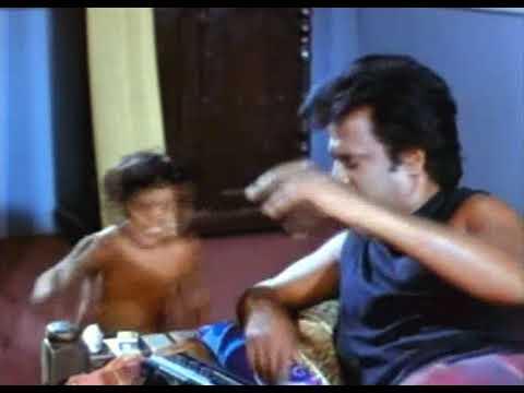 "The ""bodyguard"" from Athisaya Piravi (Indian Tamil fantasy/comedy film)Enforcer Athisaya Piravi"