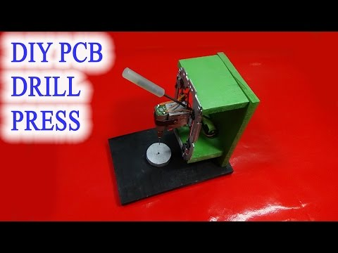 Homemade mini DIY PCB drill press table from rails CD drives