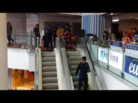 SCDF personnel inspecting escalator at Chinatown Point
