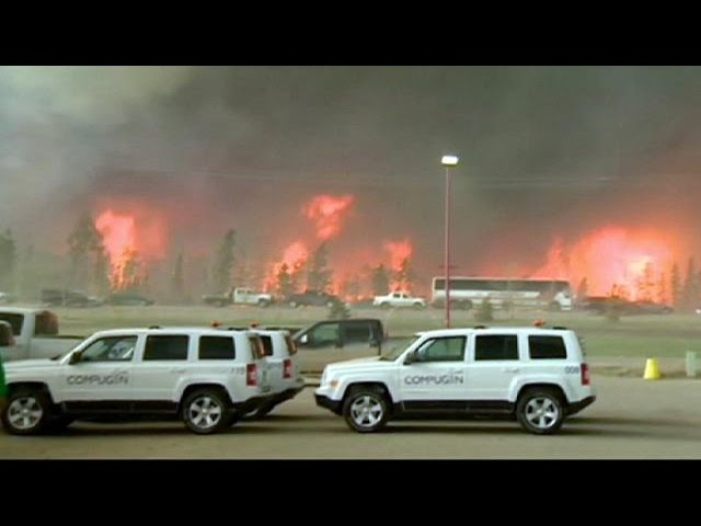 Oil workers evacuated as Fort McMurray wildfire spreads rapidly north