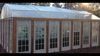 DIY hoop house built with recycled doors - greenhouse for cheap
