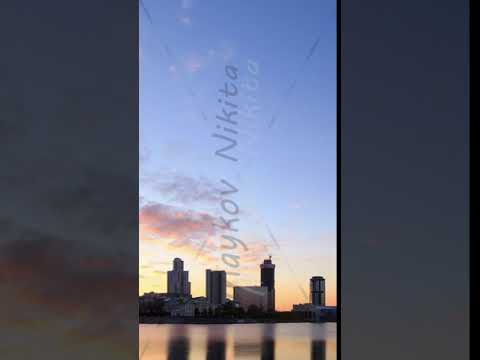 Vertical video. Sunset on the waterfront. Ekaterinburg, Russia. Time Lapse