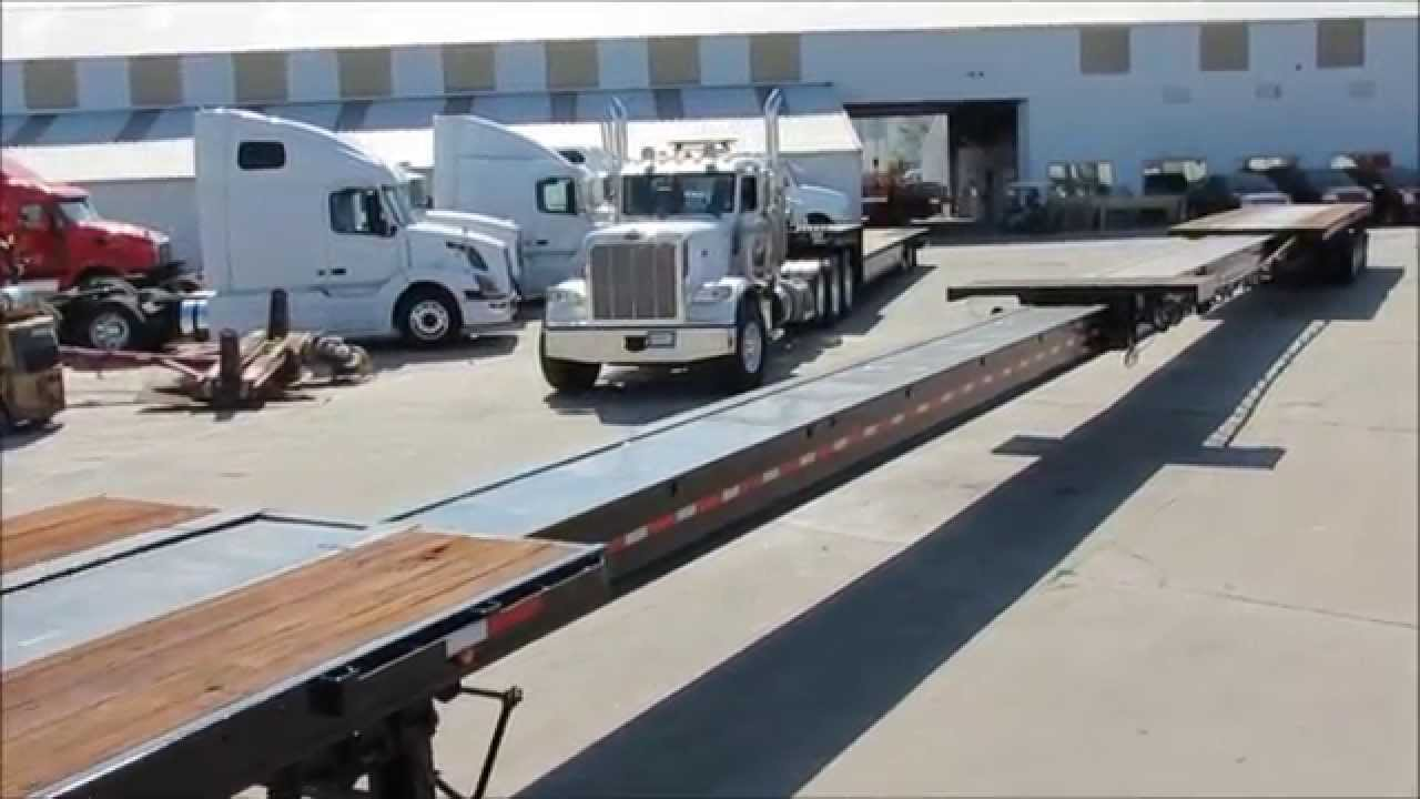 Watch on drop deck semi trailer