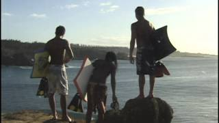 Hawaiian Boogie Boarders Looking at Ocean