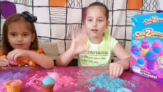 Kids video, Yasmina shows crazy sand toy games. She makes nice colored shapes.