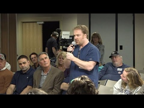 Angry Constituent TORCHES Representative At Town Hall