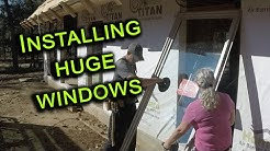 Installing large Milgard windows, Our windows are in.