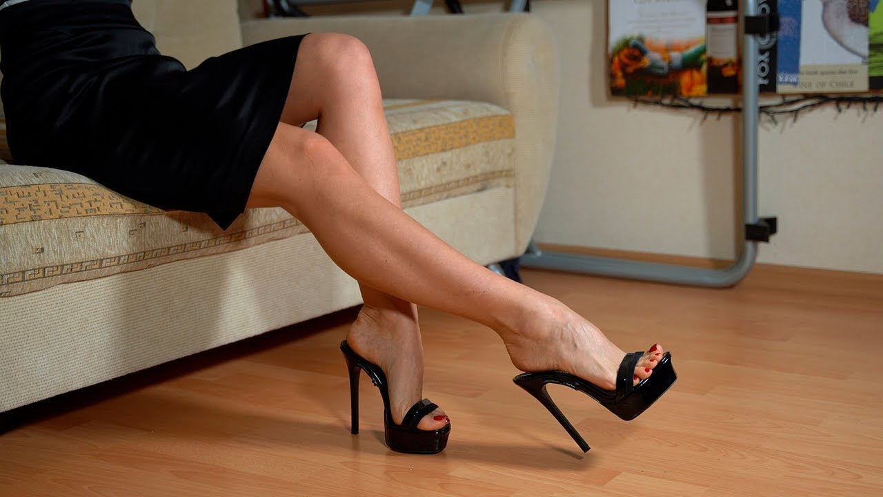I show my long legs and perfect feet in black mules