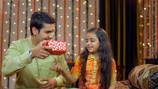 Handsome Indian brother teasing her little sister for her rakhi gift - Raksha Bandhan concept