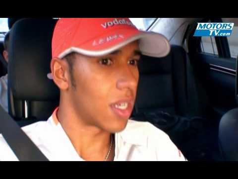 Lewis Hamilton talking to Niki Lauda driving in the Mercedes