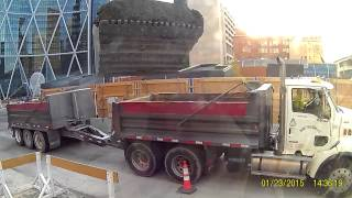 Loading trucks at Telus Sky