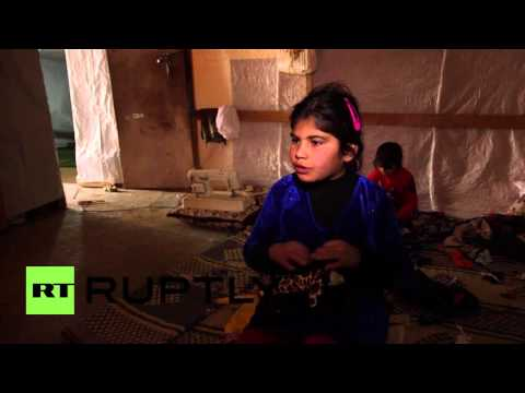 Lebanon: Syrian refugee children make dolls from leftover fabric in Bekaa Valley