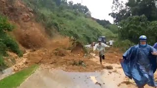 This is moment a landslide struck in quang nam, central vietnam on wednesday burying two people alive. one man was rescued but another still missing.