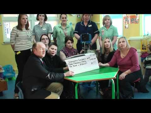 Presentation of Memories In Pink cheque to Paddington Ward
