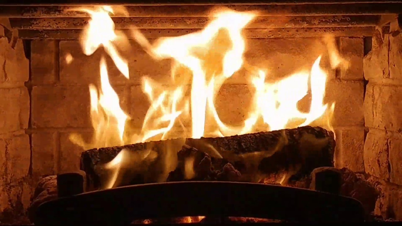 Fireplace loop - a quiet glow by a warm fire - YouTube