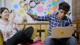 Pretty Indian girl disturbs her boyfriend for a selfie while he is working on his laptop