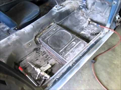 Removing the passenger side floor pan in a 1965 Mustang.