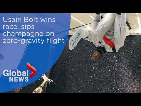 Usain Bolt wins zero-gravity foot race, celebrates with champagne