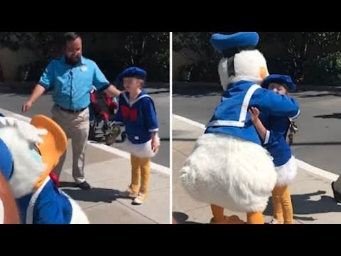 Boy named AAsher with Down Syndrome shares sweet moment with Donald Duck