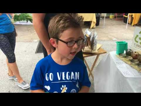 VeganEvan & Mom showing all the Vegan options at a Community Market in Orlando, Florida
