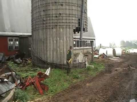Man knocks down silo with sledge hammer